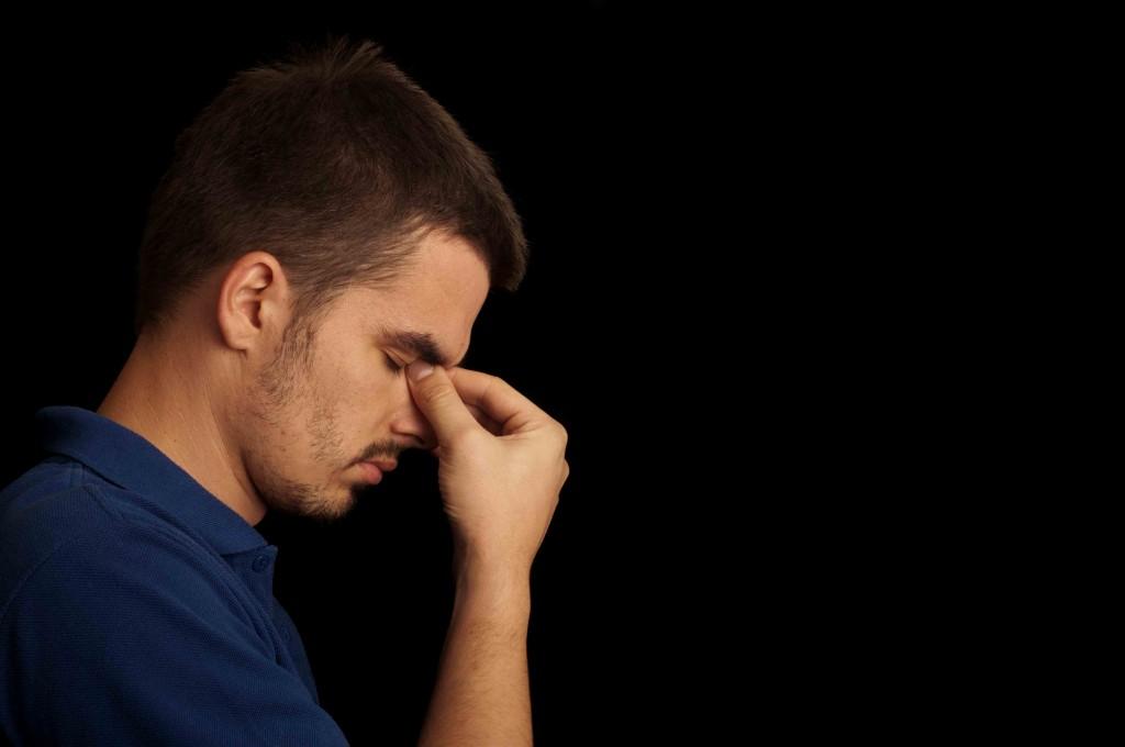 depressed man eyes closed
