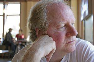 shutterstock_106025477 Older Man looking out window2