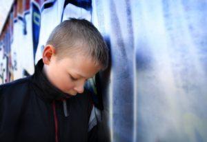 young sad boy in grief