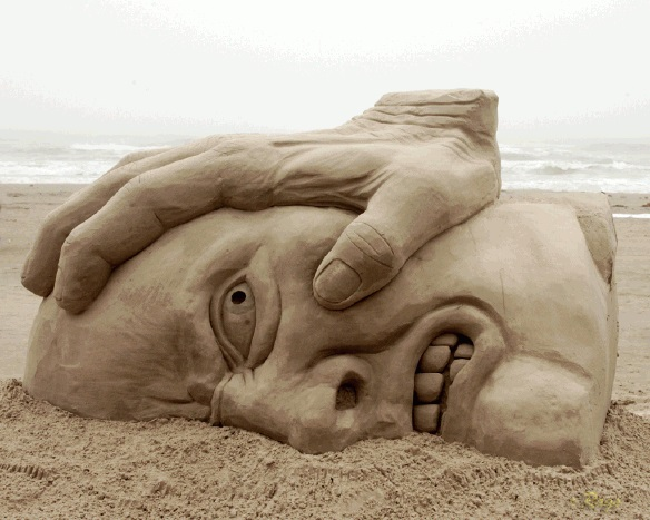 sand sculpture shows the anguish of dealing with anger
