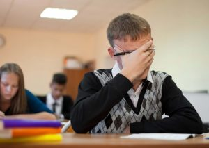 a male student in class faces exam anxiety